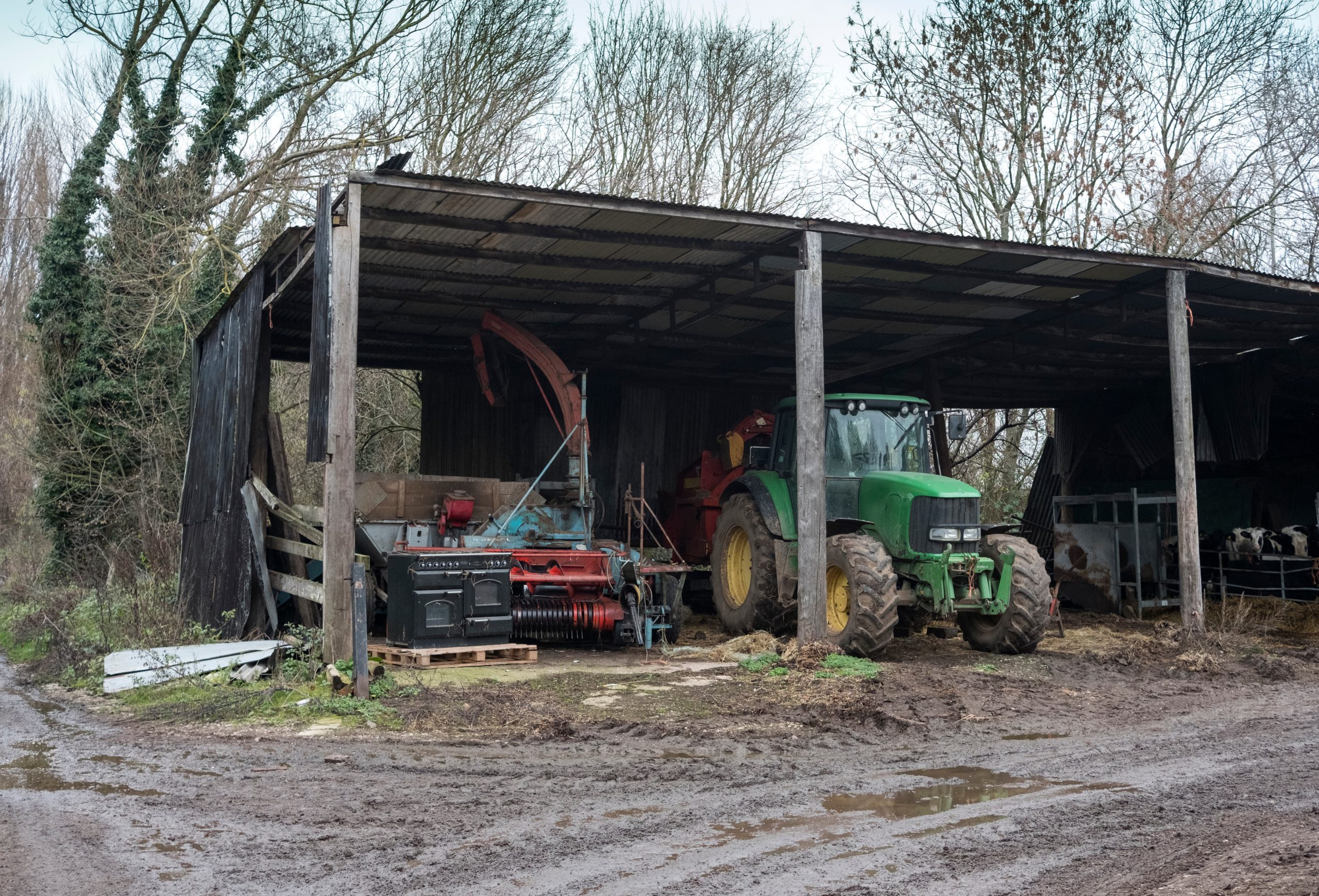 Tractor in old farm shed - TB Hub